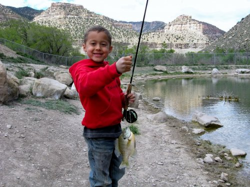 a 6-year-old catches his first bluegill at Gigliotti Pond